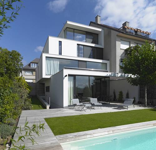 best efficient home design with four storey and landscape and outdoor patio and white siding option and green vegetation