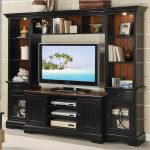 black entertainment system furniture for living room ideas with storages for media and shelves for books and beautiful  vase and decorative ceramics