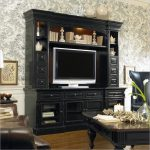 black finishing entertainment system furniture for living room with brown leather sofa and traditional rectangular coffee table