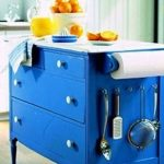 Blue Dresser Kitchern Island With Orange Fruit And Juice And Kitchen Tools Also Kitchen Towel And White Cabinet