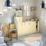 Bright Laundry Room With Basket Shelves And Yellow Cabinet And Wall Racks And Pendants And Wooden Floor And Stairs And Tile Accent