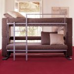 brown low profile bunk bed idea iwth velvet touch and beige pillows and red carpet and stairs and glass window
