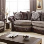 brown-sofas-in-doncaster-with-white-carpet-and-beige-floor-and-flower-over-small-sofa-table-and-pictures-on-white-wall-and-big-windows
