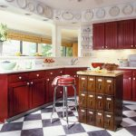 brown-wooden-kitchen-island-from-a-cabinet-and-red-high-chair-and-red-kitchen-towel-also-black-and-white-checkered-pattern-floor-with-red-kitchen-cabinet
