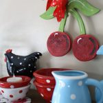 christmas decoration idea with polka dot dishes of blue cattle and red bowl and chicken and table cloth and cherry and ribbon