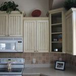 classic dull white kitchen storage diy idea with open concept and potted plant and white glossy top and tile backsplash