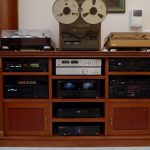 classic wooden ikea stereo cabinet idea with glass accent and stereo beneath white wall aside wooden door