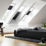 classy and stylish black and white loft bedroom design with black bedding and black area rug and skylight