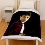 clear and fixed harry potter blanket idea in black color with picture on white bedding with wooden floor and small dresser and headboard