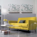 clear nesting side tables and coffee table a yellow couch with grey pillow beautiful wall sticker in floral theme an open shelves room divider