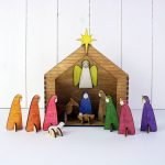 colorful modern nativity design with church and colorful people hoods