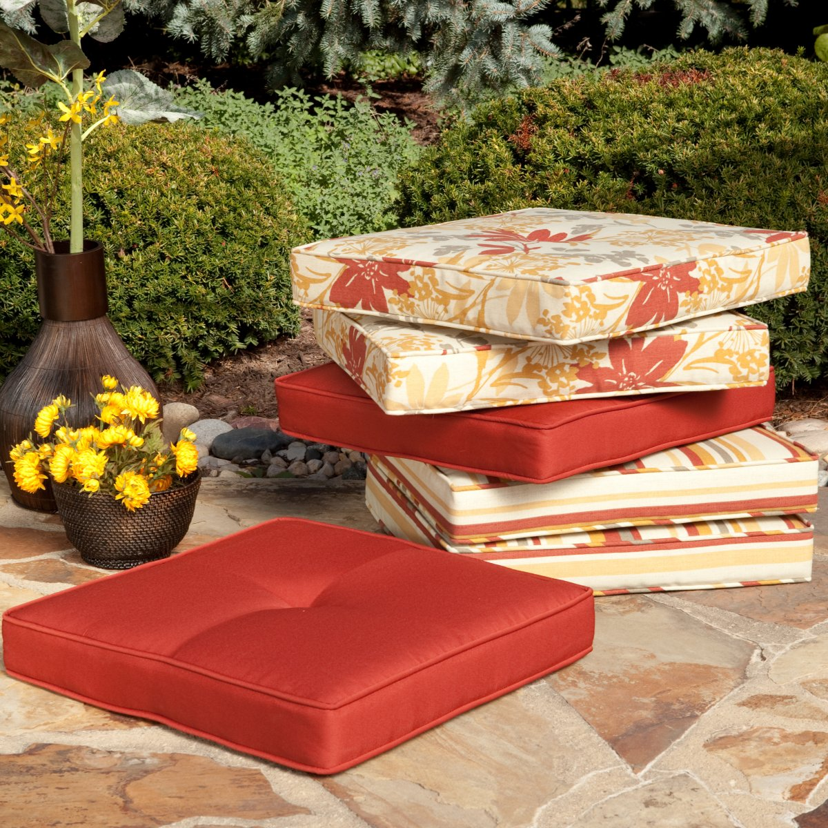 colorful tropical target outdoor cushions idea in red and cream color with pattern on concrete patio with shrub