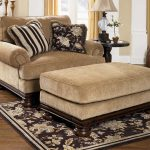 comfortable-Wood-Trim-Oversized-chair-with-ottoman-in-beige-color-and-in-living-room-with-brown-and-flower-pattern-of-the-rug
