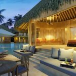Comfortable And Luxurious Resort Design With Modern Gray Couch And Dining Set And Swimming Pool And Umbrella Patio And Hut