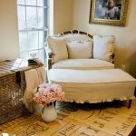 comfortable-and-nice-white-oversized-chair-with-ottoman-in-the-corner-room-near-pretty-roses-in-white-vase-and-rattan-big-basket-also-a-family-photo
