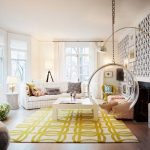 comfortable interior with black white wallpaper with hanging chair and yellow patterned area rug and wooden floor and glass window