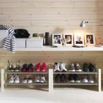cool-and-fancy-shoe-racks-with-white-color-design-and-pictures-and-white-boxes-and-table-lamp-near-wooden-wall