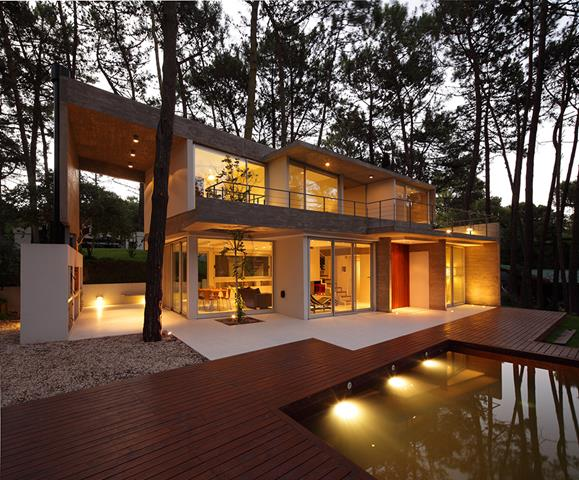 cool private dream house design with open plan overlooking pool with wooden deck and beneath shaddy tree