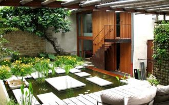 courtyard design with pond idea with wooden deck patio with seating and canopy and plants