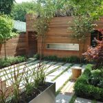 Creative Small Backyard Patio Design With Even Concrete Walkway And Wooden Fence And Fireplace And Climbing Plant And Planter Box And Log Bench