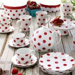 cute and lovely polka dot dishes in red and white combination of plate cup bowl cattle and rustic table