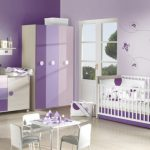 Cute And Sweet Baby Girl Bedroom With Soft Purple Theme In Different Purple Saturation Combined With White Color For The Crib And Table Set
