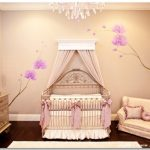 cute-sweet-and-nice-baby-girl-bedroom-with-canopy-for-the-crib-and-pink-ribbons-and-purple-flower-wallpaper-also-white-rug-on-wooden-floor