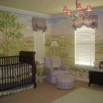 cute-sweet-and-nice-baby-girl-bedroom-with-green-scenery-wallpaper-and-wooden-crib-and-white-nursery-chair-and-ottoman-in-the-corner