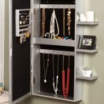 darlington hanging jewelry airmore made of aluminum plus mounted on the wall with small shelves for photoframe and decorative pot