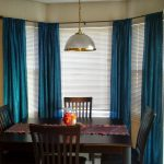 effortless dining room ideas with wooden rectangular table and wooden chair plus curtain rods for bay windows with blue curtain and blinds