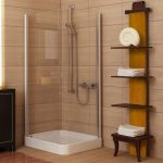 elegant brown and yellow wooden towel shelf with creamy siding and corner shower and wooden floor and glass window
