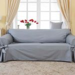 elegant gray couch cover idea with tied model in living room with gray area rug and dresser and glass window and creamy curtain