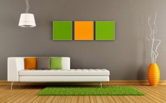 elegant gray olympic paint premium idea with orange and green wall palete and white luxurious sofa bed and colorful cushions and green rug on wooden flooring with honey deeper pottery