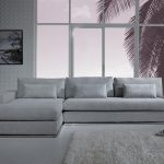 elegant gray sectional sofa with chaise idea with soft cushiosn beneath large glass window with gray area rug