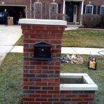 elegant reddish brick mailbox idea with tall design and box planter and white accent and black box