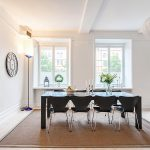 elegant-white-dining-room-with-black-dining-table-and-black-series-7-chairs-with-three-white-windows-white-wall-floor-lamp-in-the-corner-and-a-white-pendant-lamp-also-brown-carpet