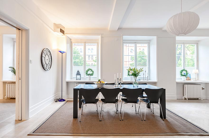 Elegant White Dining Room With Black Dining Table