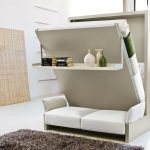 elegant white murphy bed with couch design with green accent and racks and gray rug and white couch