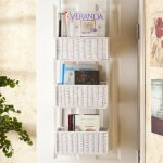 elegant white over the door basket storage design for books over white wooden door design