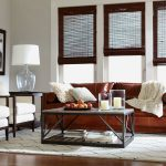 ethan allen leather furniture for stunning living room ideas with brown leather sofa and decorative cushions and white armchairs and rectangular coffee table with storage