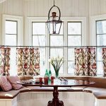 exclusive bay window design with brown banquette and tropical home garden curtain design with round wooden table and classic chandelier