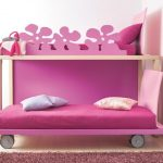 feminine girls room idea with low profile bunk bed in purple tone with flower railing and wheels and purple rug
