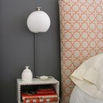 floating-nightstand-with- screwdriver-from- wooden-box-and-painted-in-white-and-decorate-with-finishing-nails-also-books-inside-and-white-lamp-hang-on-gray-wall