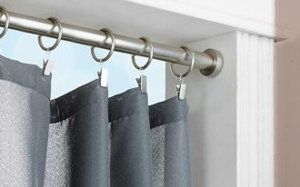 gorgeous and firm tension rod curtain idea with gray silky curtain design with round slider beneath white wall