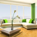 gorgeous and spacious modern ikea living room idea with white sofa and green cushions and curtain and glass coffee table with lily and opan plan