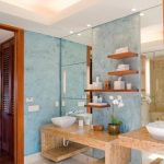 gorgeous bathroom interior design with blue textured wall idea and wall mirror and beige wooden vanity idea