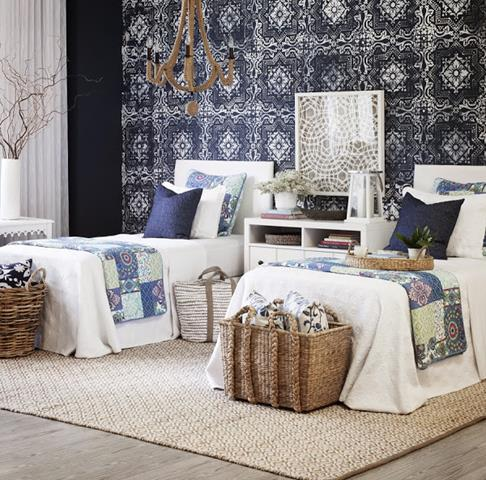 gorgeous black and white bedroom design with patterned peel and stick paper with unique vanity table and rattan basket and creamy rug
