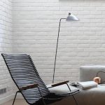 gorgeous black rocking chair ikea with modern style in white living room with white brick wall and gray sofa and browm area rug and floor lamp