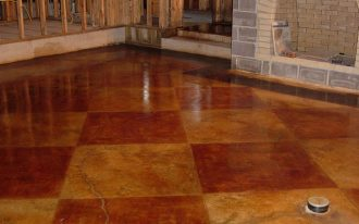 gorgeous floor painting idea with plaid pattern with yellow and caramel tone for interior with natural stone siding