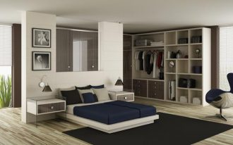 gorgeous large floor to ceiling dress up storage idea in the bedroom with navy blue sheet and black area rug